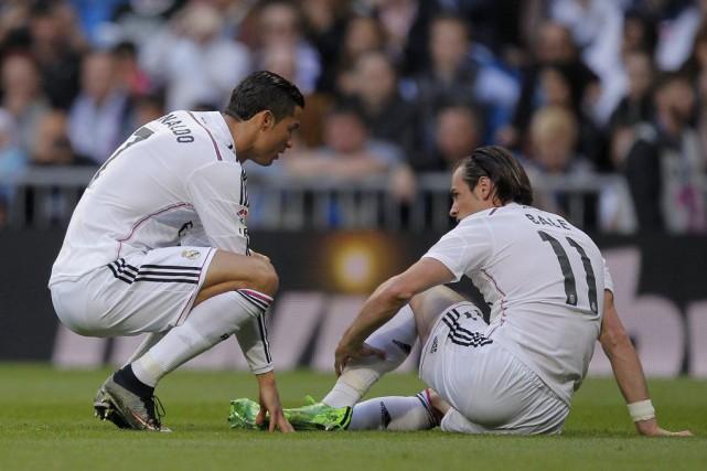 Gareth Bale s'est blessé aumollet.... (Photo Andres Kudacki, AP)