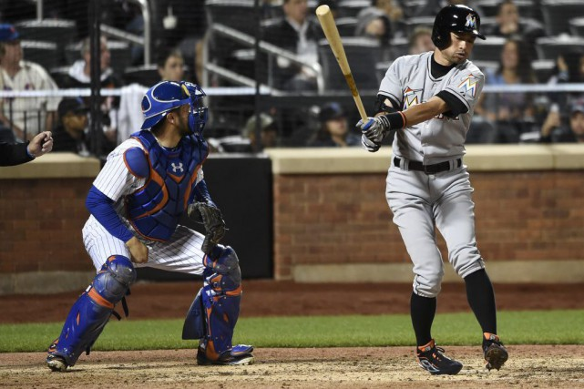 Le receveur des Mets de New York, Travis d'Arnaud.... (Photo Kathy Kmonicek, AP)