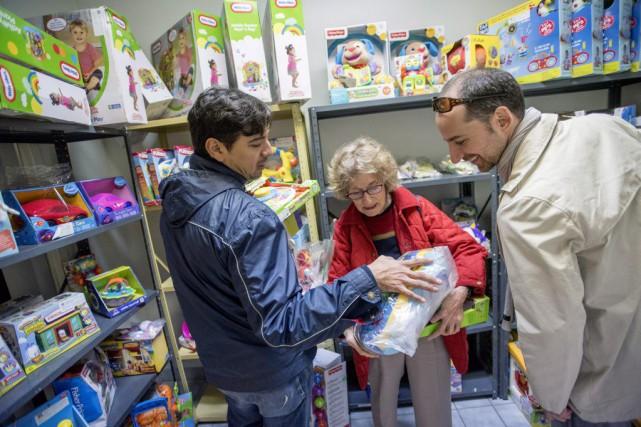 Les familles participaient elles aussiau rapport annuel évaluant... (Photo Justin Tang, La Presse Canadienne)
