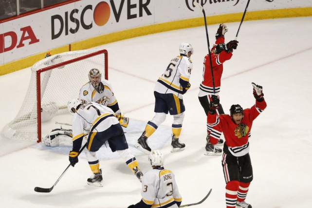 Les Blackhawks feront face au gagnant de l'affrontement... (Photo Kamil Krzaczynski, USA TODAY Sports)