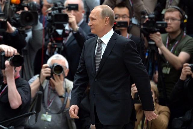 Le président russe Vladimir Poutine dirige la Russie... (PHOTO ALEXEI DRUZHININ, AGENCE FRANCE PRESSE)