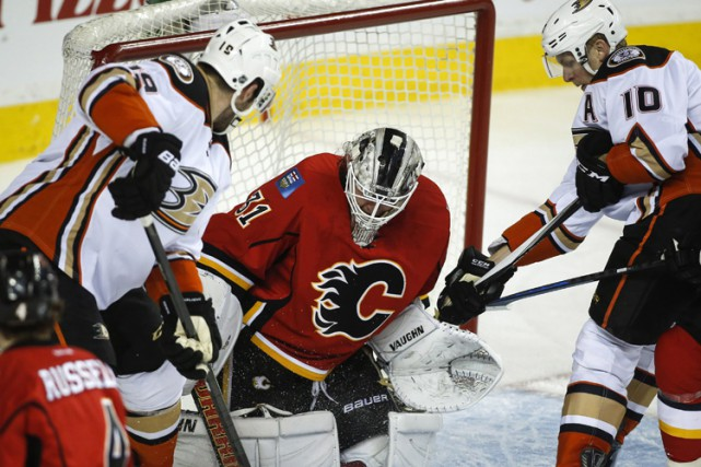 Si les Flames de Calgary veulent poursuivre leur conte de fées en séries... (Photo: PC)