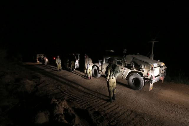Des soldats israéliens patrouillent près de la frontière... (Photo Jalaa Marey, AFP)