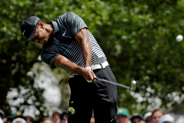 Tiger Woods... (Photo Chris Carlson, AP)