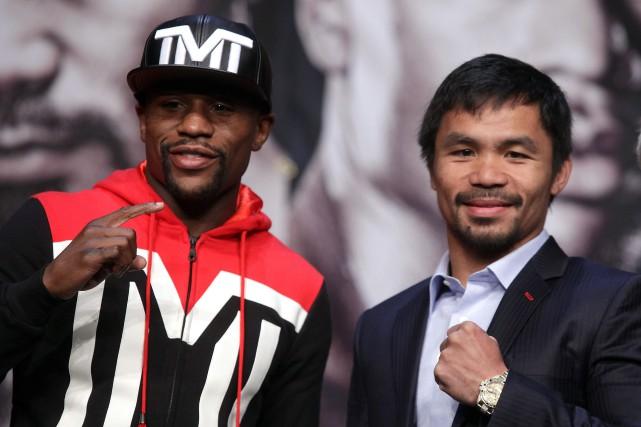 Manny Pacquiao et Floyd Mayweather... (PHOTO JOHN GURZINSKI, AFP)