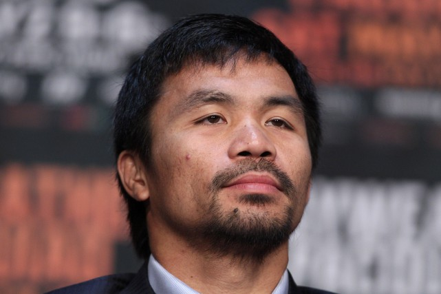 Manny Pacquiao... (PHOTO JOHN GURZINSKI, AFP)