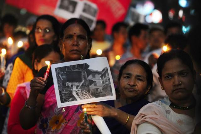 À Allahabad, des membres de la société népalaise... (PHOTO SANJAY KANOJIA, AFP)