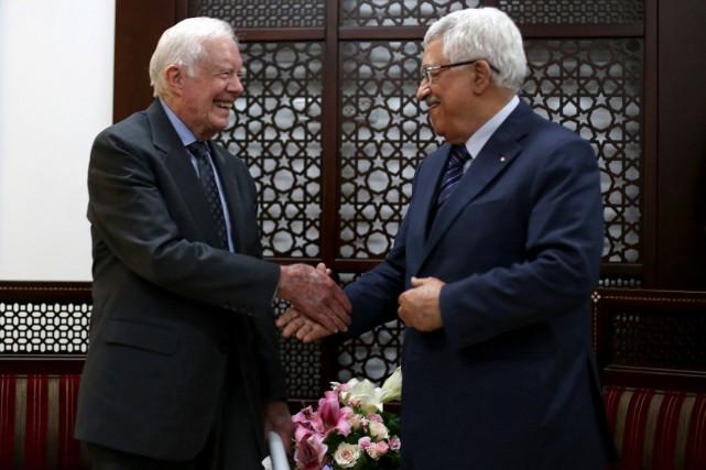 L'ancien président américain Jimmy Carter (à gauche) a... (Photo Abbas Momani, AP)
