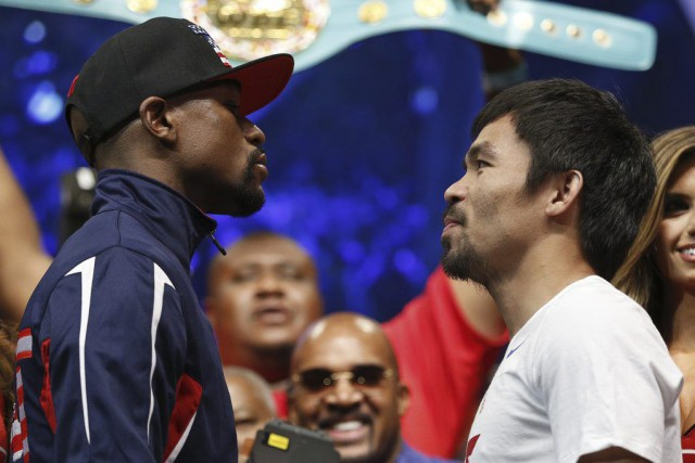 Déjà riches à coup de millions, Mayweather et... (PHOTO JOHN LOCHER, AP)