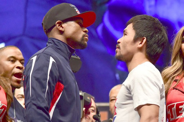 Floyd Mayweather et Manny Pacquiao... (PHOTO FREDERIC J. BROWN, ARCHIVES AGENCE FRANCE-PRESSE)