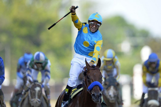 Victor Espinoza a été le jockey vainqueur de... (PHOTO JAMIE RHODES, USA TODAY)