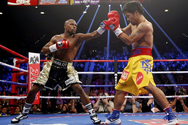 Floyd Mayweather et Manny Pacquiao... (Photo Steve Marcus, archives Reuters)
