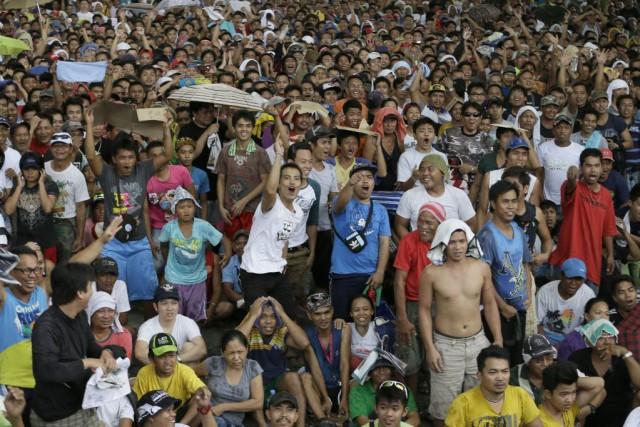 Des millions de personnes s'étaient rassemblées dans des... (Photo Bullit Marquez, AP)