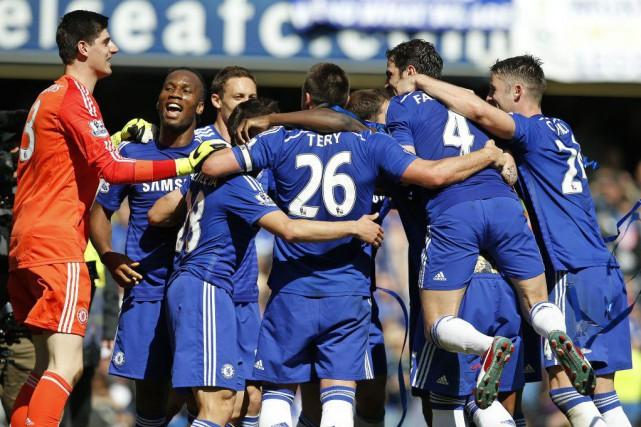 Chelsea savoure son premier championnat d'Angleterredepuis 2010.... (Photo Alastair Grant, AP)