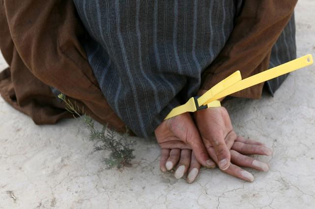 La Commission d'examen des plaintes contre la police militaire (CPPM) s'est... (PHOTO JOHN D MCHUGH, AFP)