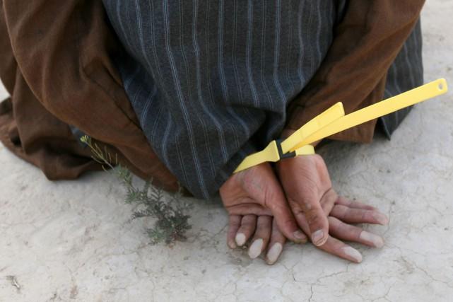 Les policiers militaires en mission en Afghanistan n'auraient... (PHOTOJOHN D McHUGH, ARCHIVES AGENCE FRANCE-PRESSE)