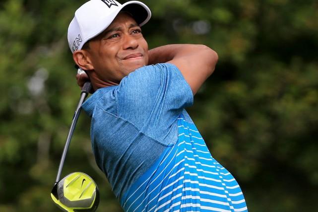 Tiger Woods vit des jours difficiles et ses... (Agence France-Presse, Archives)