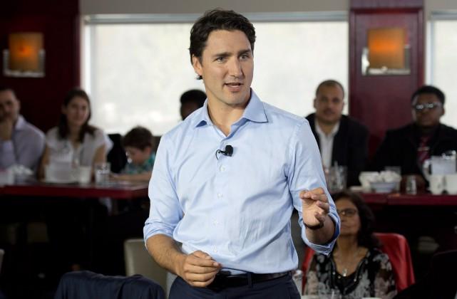 La mise en scène organisée par Justin Trudeau... (PHOTO ADRIAN WYLD, LA PRESSE CANADIENNE)