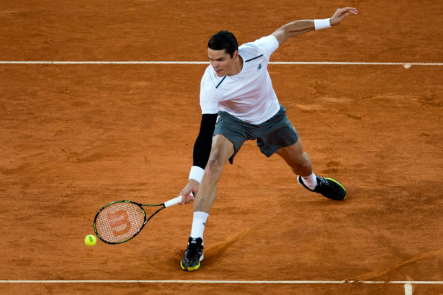 Milos Raonic... (Photo Paul White, AP)