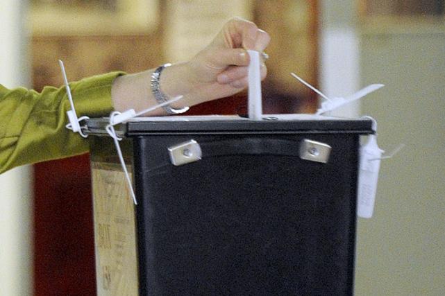 Aux élections législatives britanniques, 113 personnes ont voté jeudi pour un... (Photo Andy Buchanan, AFP)