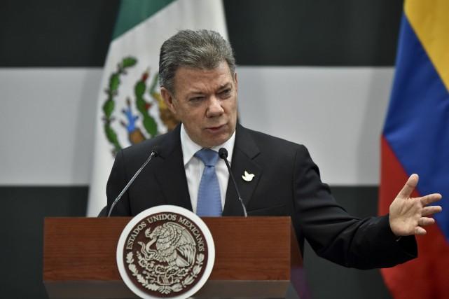 Le président colombien Juan Manuel Santos... (Photo Yuri CORTEZ, AFP)