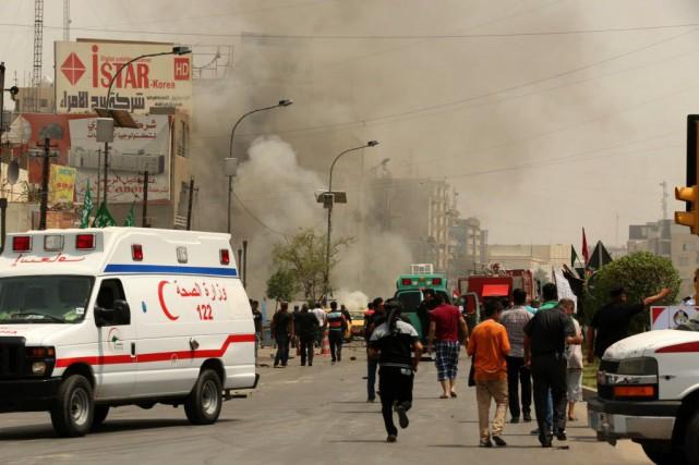 Une voiture piègée s'est fait exploser à Bagdad.... (Photo Hadi Mizban, AP)