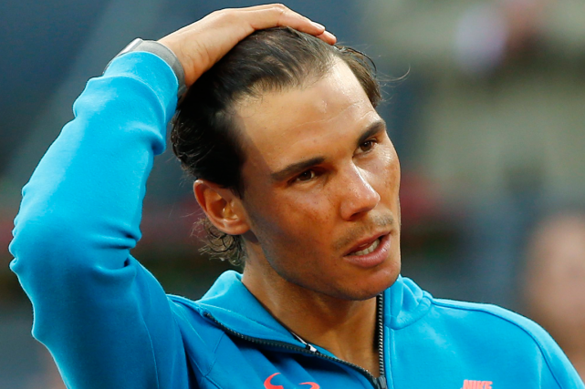 Rafael Nadal a été évincé du top 5 mondial... (Photo Paul White, AP)