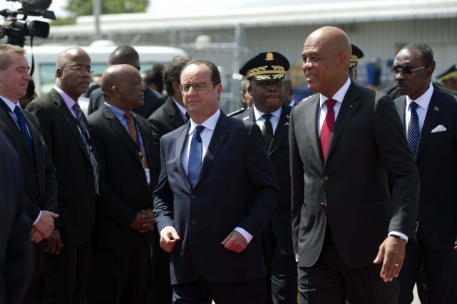 Le président Martelly a déclaré à son homologue... (PHOTO HECTOR RETAMAL, AFP)
