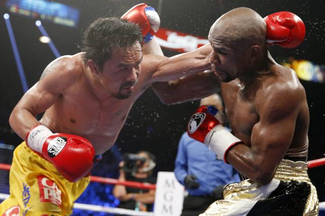 Le combat entre Manny Pacquiao etFloyd Mayweathera généré... (Photo John Locher, AP)