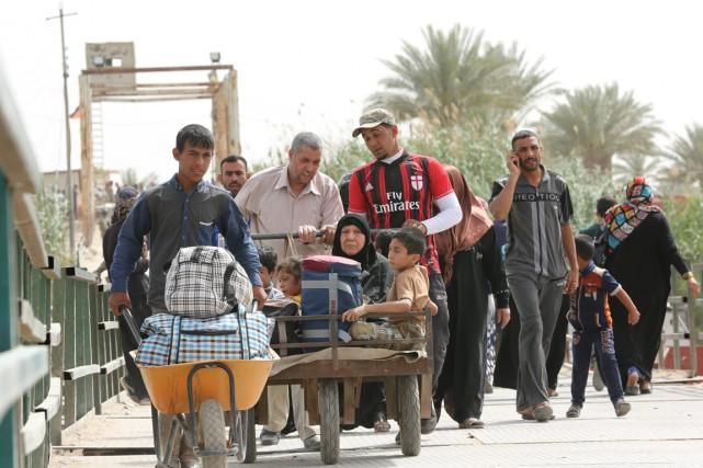 L'organisation précise que 133000 personnes ont dû quitter... (PHOTO HADI MIZBAN, ARCHIVES AP)