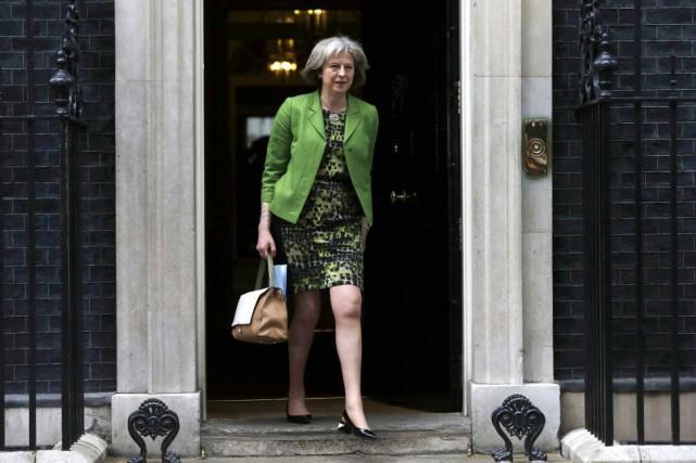 Theresa May, la ministre britannique de l'Intérieur.... (PHOTO SUZANNE PLUNKETT, REUTERS)