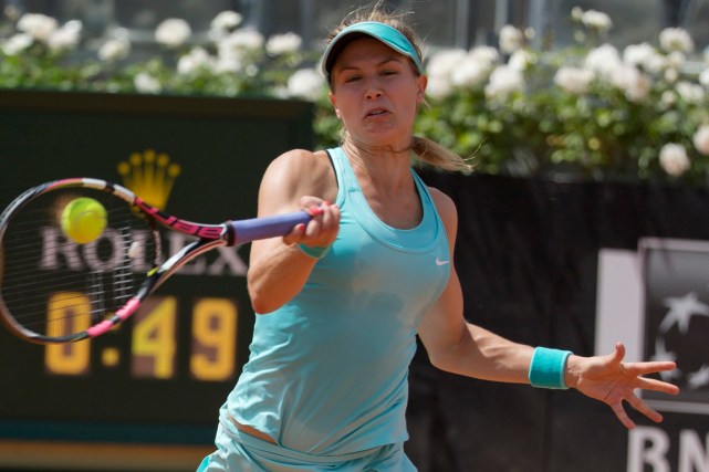 Eugenie Bouchard a peiné au service, commettant six doubles... (Photo Andrew Medichini, AP)