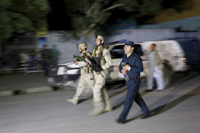 La police de Kaboul et la mission de... (PHOTO MOHAMMAD ISMAIL, REUTERS)