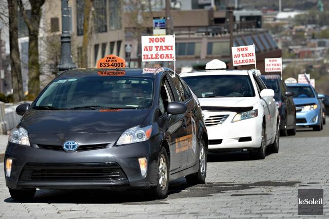 L'industrie du taxi traditionnel juge nécessaire un encadrement... (Photo Patrice Laroche, archives Le Soleil)