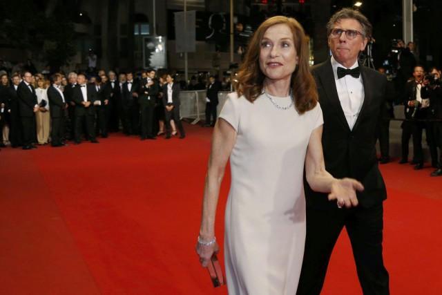 L'actriceIsabelle Huppert en compagnie duréalisateurJoachim Trier.... (Photo REGIS DUVIGNAU, Reuters)
