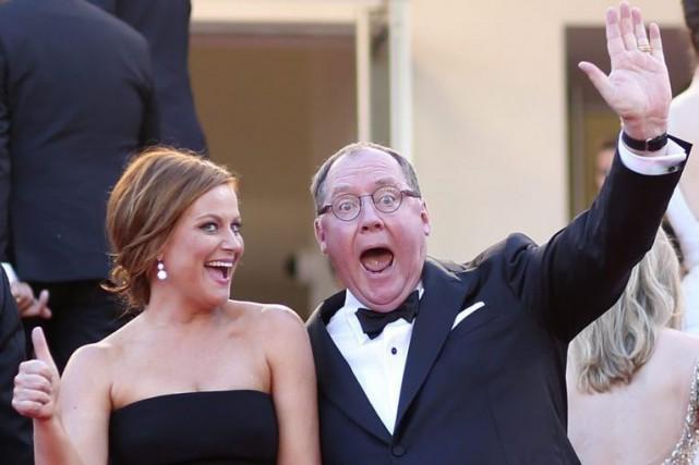 Amy Poehler en compagnie de John Lasseter.... (Photo: AP)