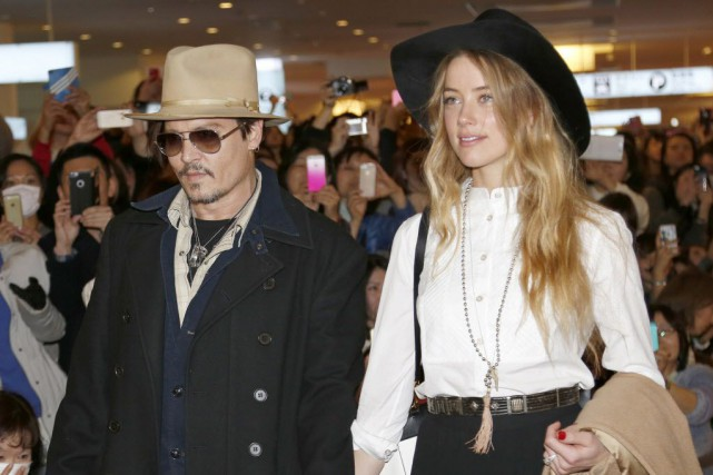 Johnny Depp et Amber Heard... (Photo Shizuo Kambayashi, archives AP)