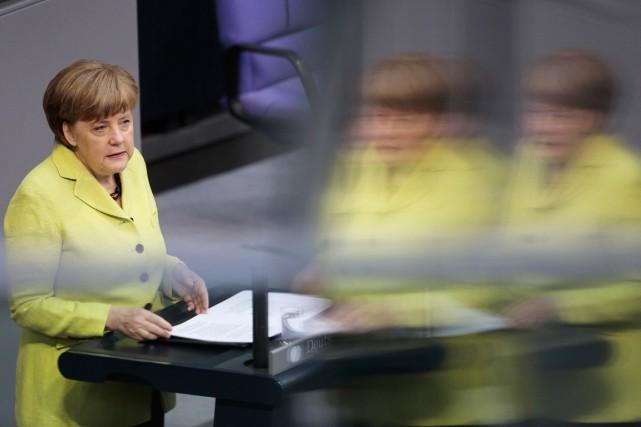 La chancelière allemande Angela Merkel lors de son... (PHOTO MARKUS SCHREIBER, AP)