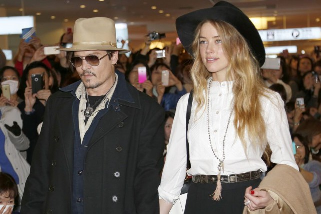 Johnny Depp et sa copine Amber Heard.... (Photo: archives AP)