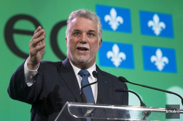 D'un côté, le premier ministre du Québec et... (Photothèque Le Soleil)