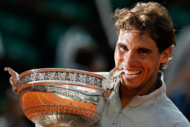 Rafael Nadal a remporté Roland-Garros à neuf reprises,... (Photo Darko Vojinovic, archives AP)