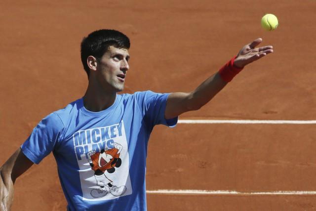 Roland-Garros est le dernier grand titre qui fait... (PHOTO PATRICK KOVARIK, AFP)
