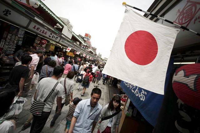 «L'économie japonaise continue de se redresser modérément», a... (PHOTO EUGENE HOSHIKO, ARCHIVES AP)