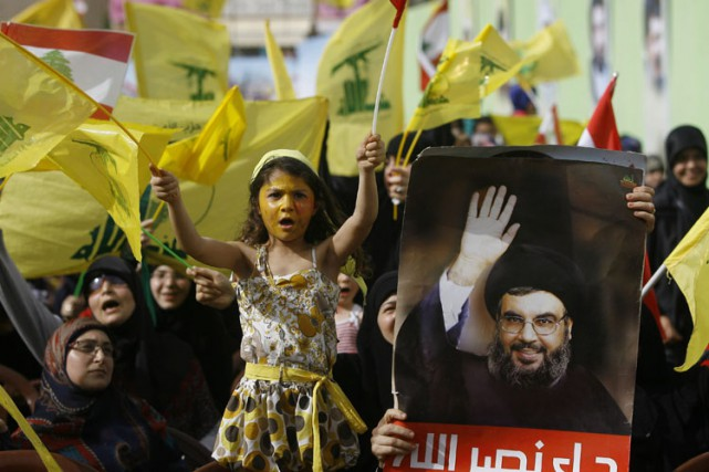 Des partisans du Hezbollah manifestent dans la ville... (Photo: AP)