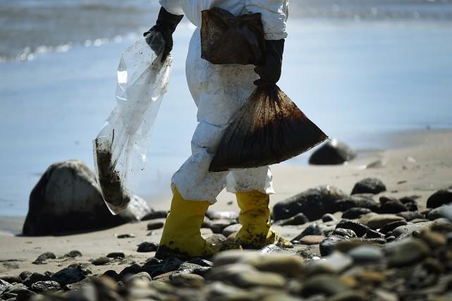 Les compagnies pétrolières et gazières bénéficieront en 2015... (PHOTO MARK RALSTON, AFP)