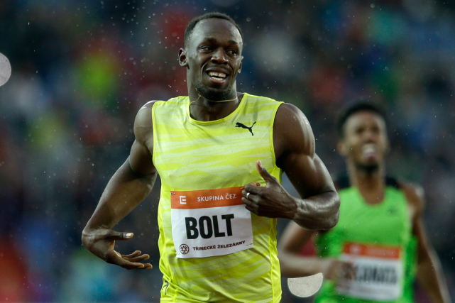 Usain Bolt... (Photo Michal Cizek, AFP)