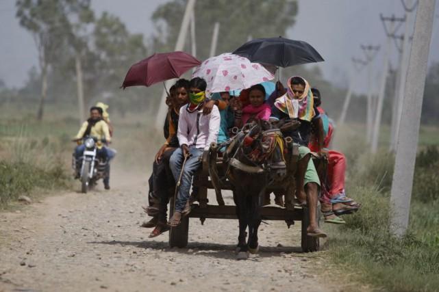 Les prévisionnistes anticipent peu d'amélioration de la météo... (Photo Channi Anand, AP)