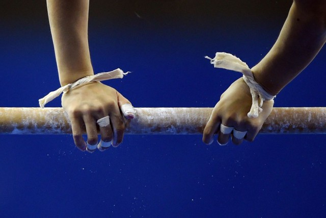 Les gymnastes d'âge senior vont se battre pour... (Greg Baker, Archives Agence France-Presse)