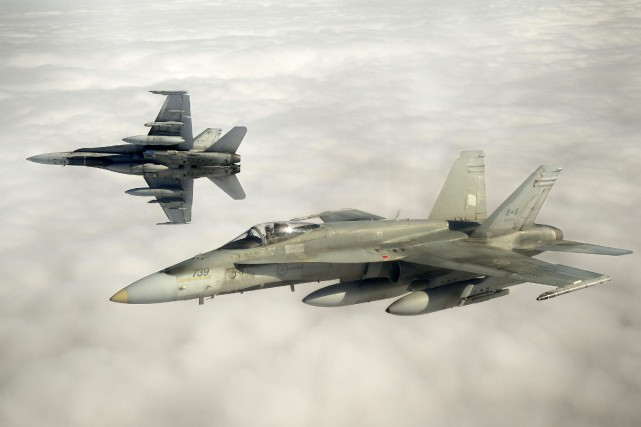 Des CF-18 de l'armée canadienne participeront aux exercices.... (PHOTO ARCHIVES REUTERS)