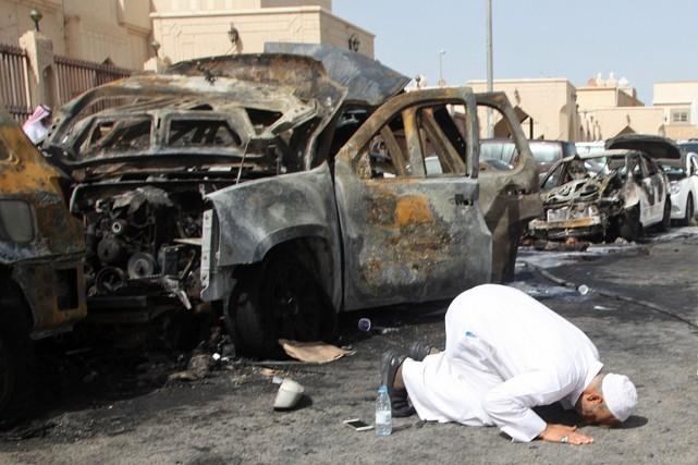 Le cousin de l'une des victimes de l'attentat-suicide... (PHOTO AFP/STR)